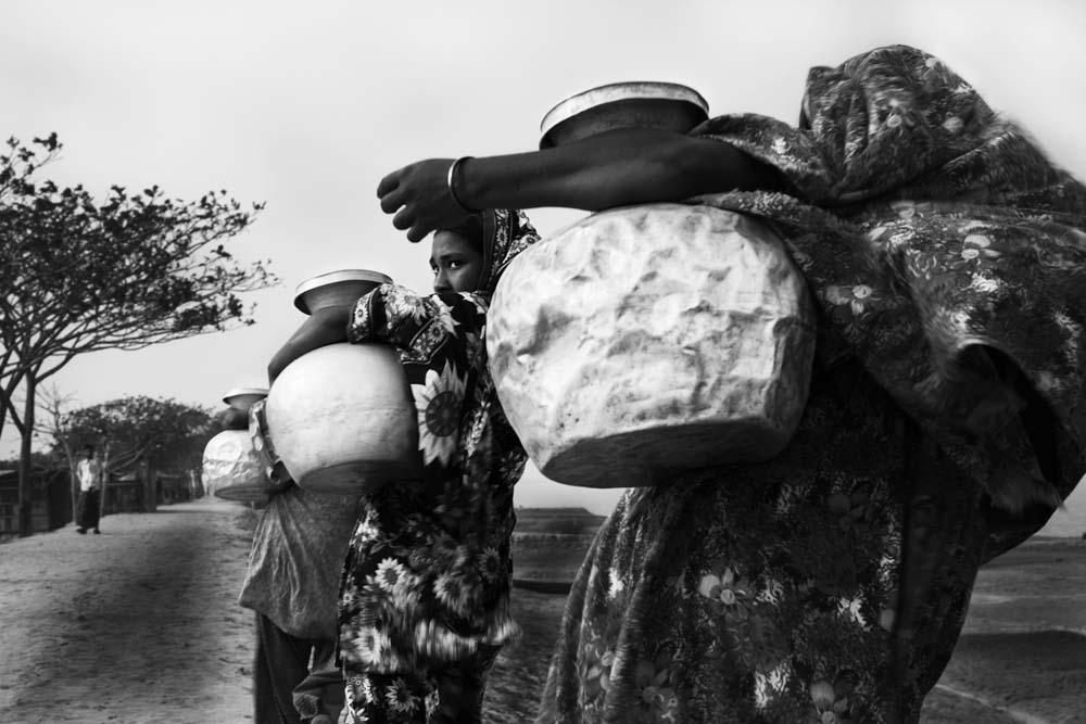 Women Carrying Water Pitchers
