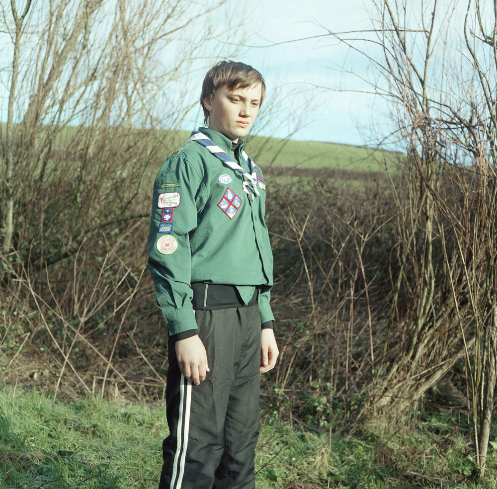 A 13-year-old boy stands proud in his scout uniform at a small farm near Laugharne in Carmarthenshire, on the edge of the Landsker line. The Landsker line is an invisible but definite line that has been present for nearly a thousand years and divides the South West corner of Wales from the rest of the country.