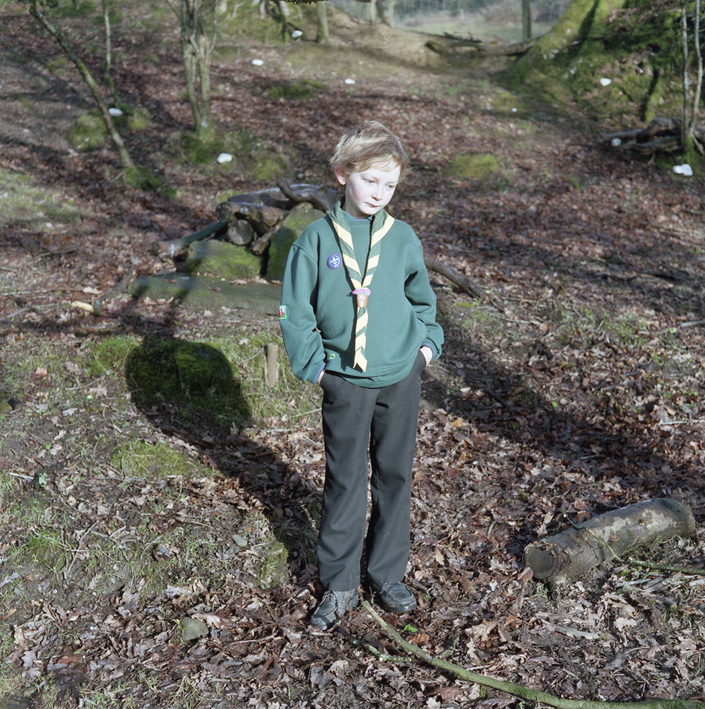 Cub Scouts are young people aged between 8 and 101Ú2 year old. Easily recognized by their distinctive dark green sweatshirt and Group scarf. Here Zach aged 10 and a member of the Carmarthenshire scouts stands in a woodland area nearLaugharne south of the landsker line.