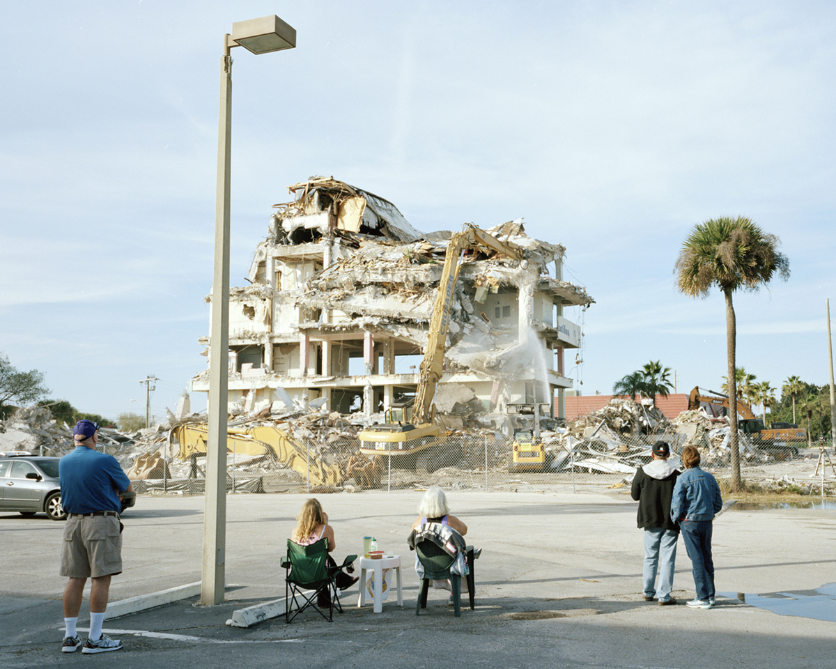 Spectators watch the demolition of the Glass Bank building in Cocoa Beach, former home of Ramon's Rainbow Room, 2015