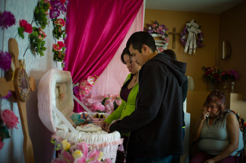 Chelsea and Wade say goodbye to their infant daughter, during her wake, in Fort McKay. Chelsea suffered a miscarriage five months into her pregnancy. Cancer, stillbirths, miscarriages and other serious health problems are prevalent in Fort McKay and Fort Chipewyan. While the cause is uncertain, local healthcare professionals have been sounding alarms over pollution levels and calling for an in-depth health study for many years.