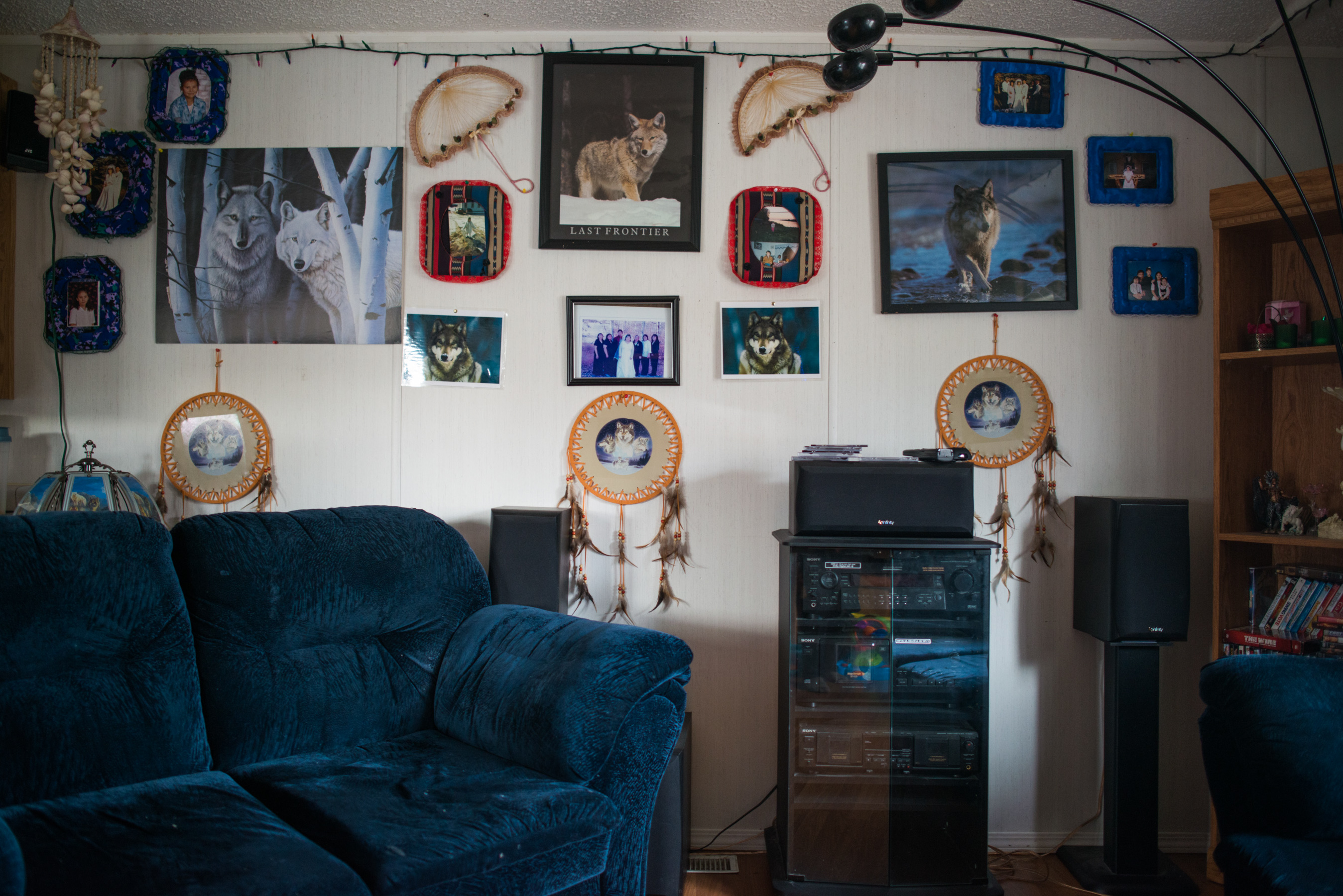 A typical living room in Fort Chipewyan shows a dichotomy between modern comforts and traditional indigenous culture. Industrial developments in the region have brought some money luxuries to the reserve.