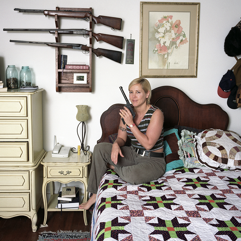 Clair Sherwood with her Guns and her Grandmother's Quilt, Atlanta, Georgia, 1997.