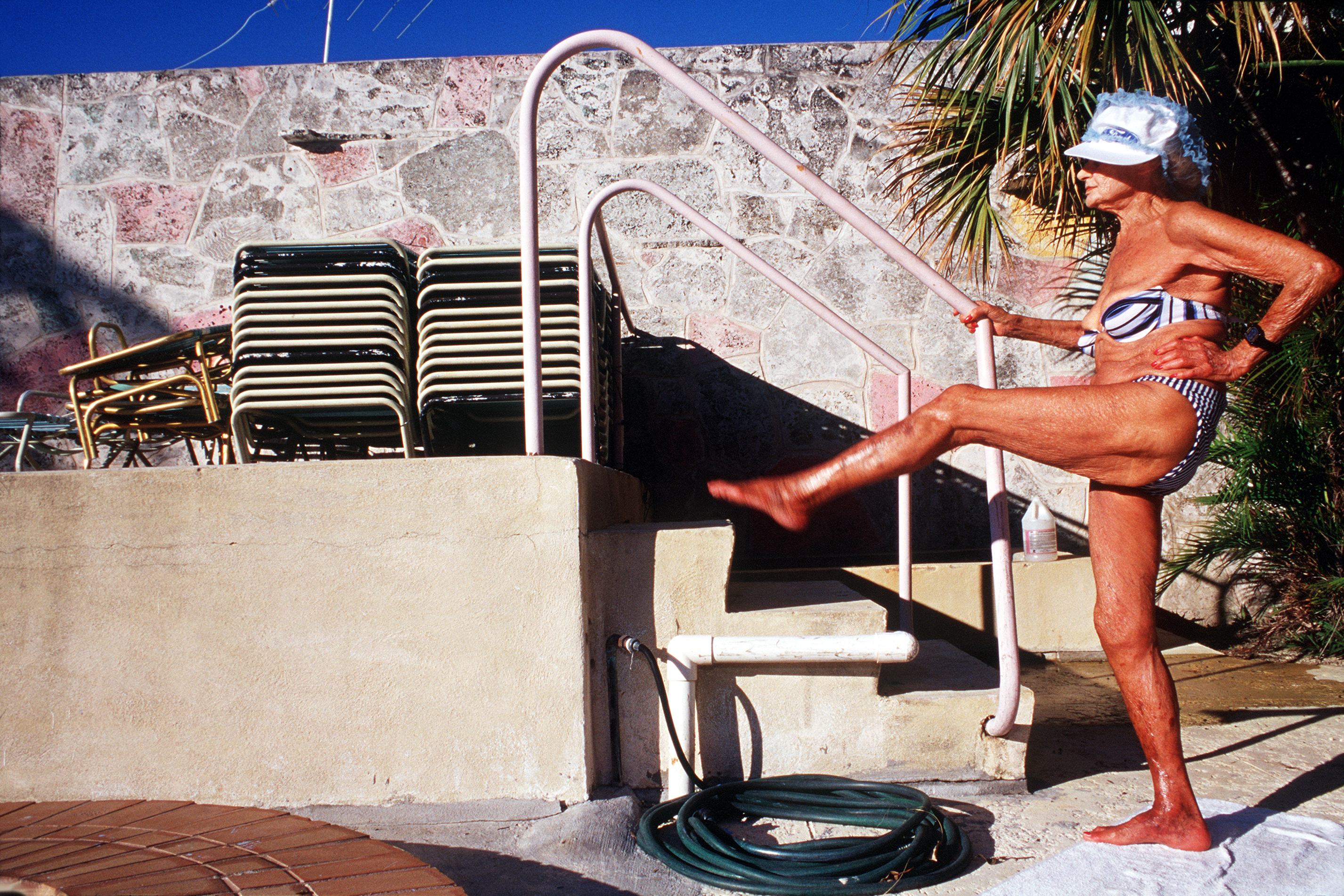 Gina Doing Exercises By Pool, 2000