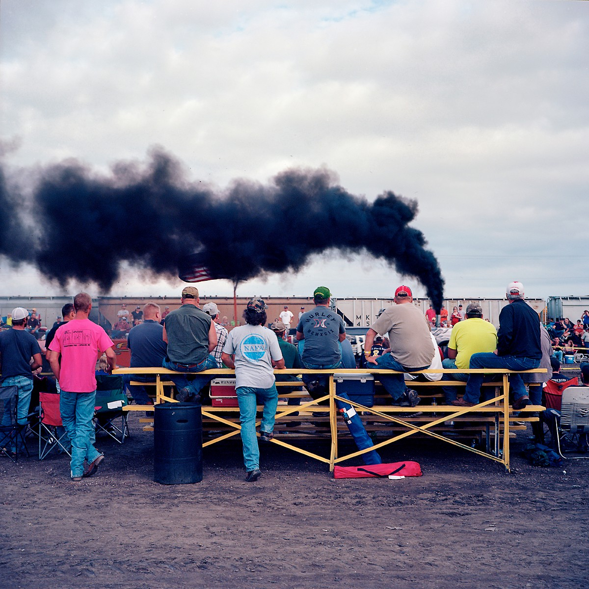 Men watch a tractor pull in Plymouth, Nebraska. The tiny town is six and a half miles from where the proposed Keystone XL pipeline would be constructed.