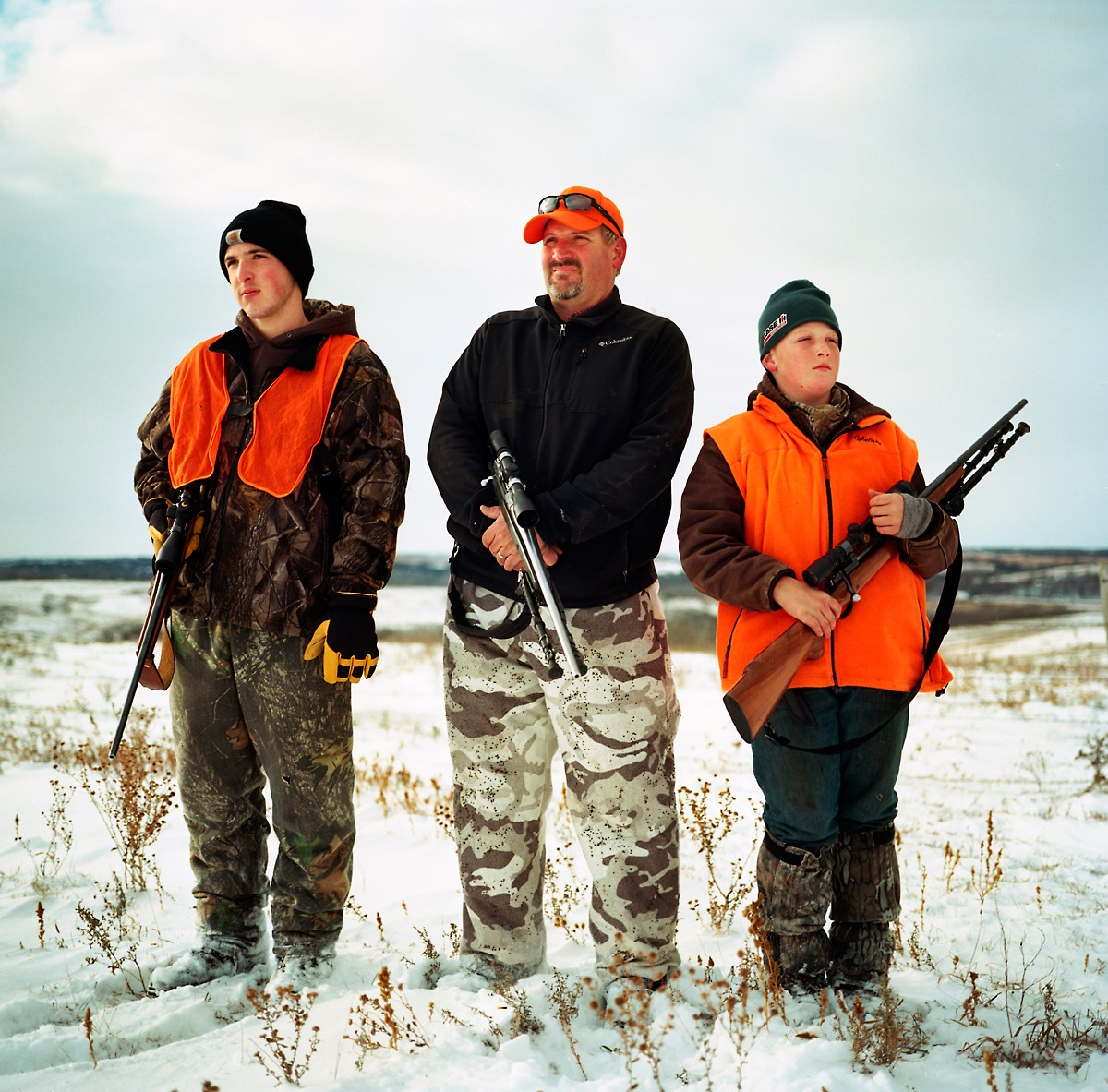 Jake Crumly, 15, left, father Ryan Crumly, and Zach Crumly hunt for deer on opening weekend on their family's property near Page, NE. The proposed Keystone XL would cut through their family's property.