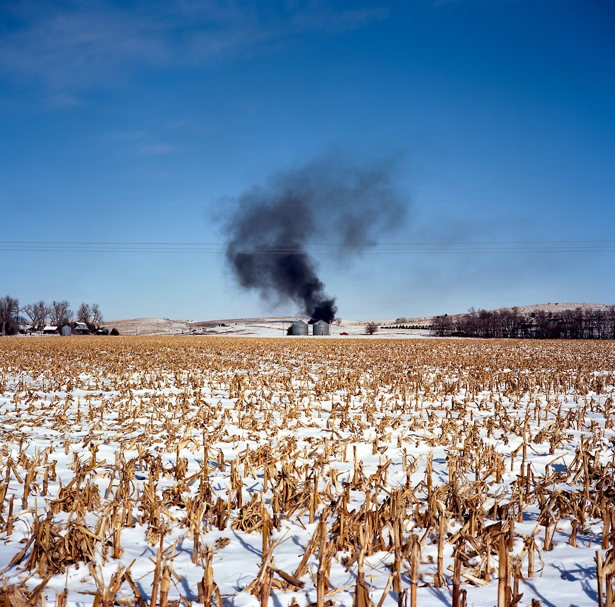 A fire burns on a corn farm in Antelope county, along U.S. Route 275. The proposed Keystone XL pipeline would cross through large patches of farms and ranches in the county.