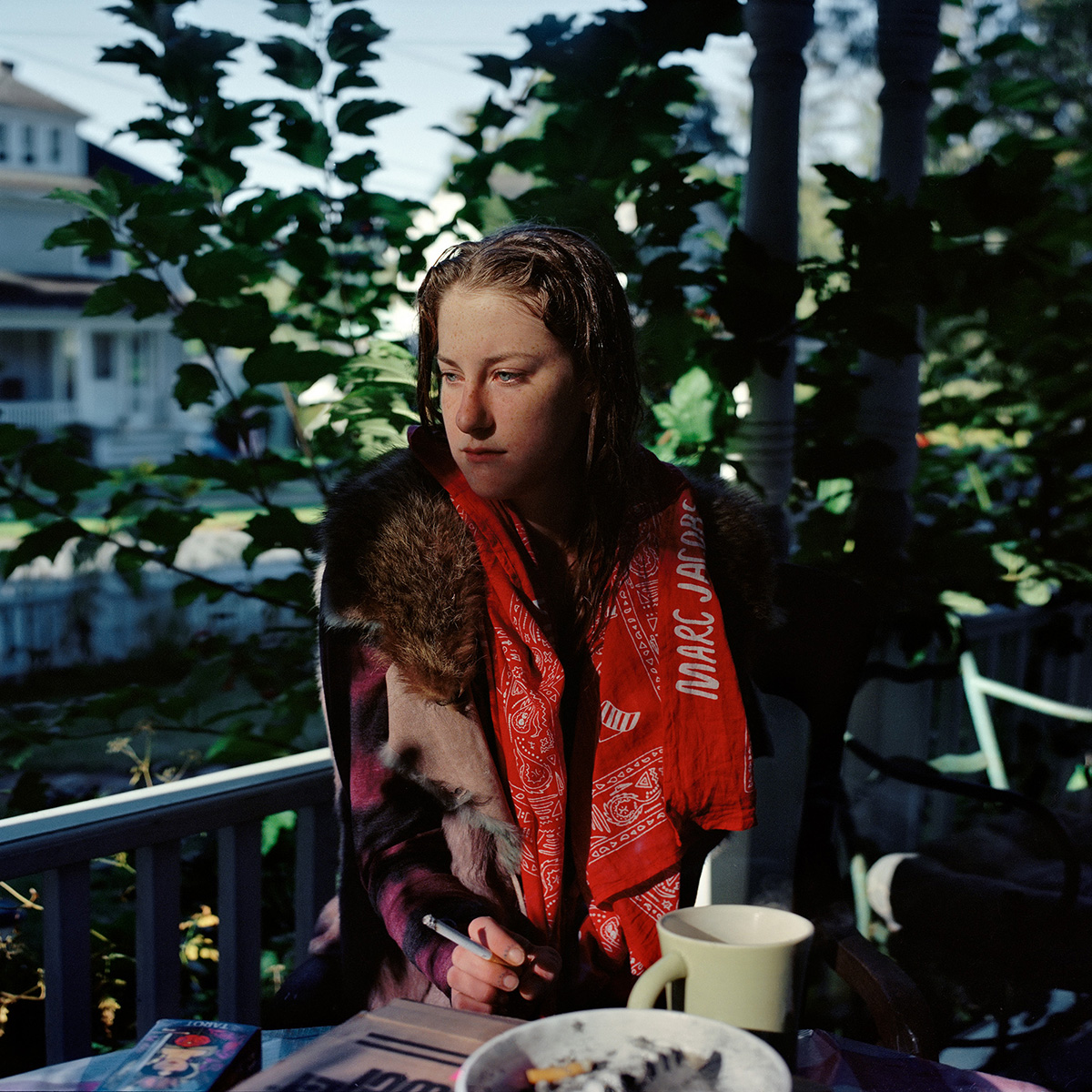 Fiona Cutting sits on the porch of her halfway house for recovering addicts before a workday at the local flower shop in Millerton, NY.