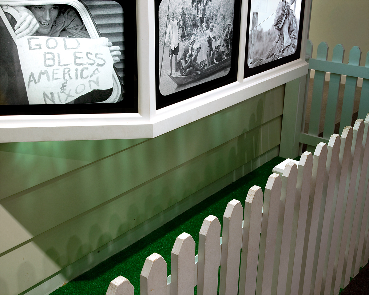"""Picket Fence"", Archival Pigment Print, 22x27"" and 28x34"", 2011. A display showing a clash between American idealism and television images of unrest at home and abroad, Richard Nixon Presidential Museum (Yorba Linda, CA)."