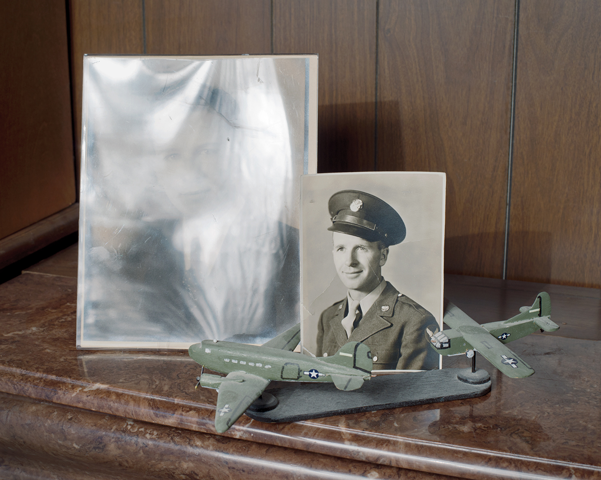 """Before & After"", Archival Pigment Print, 22x27"" and 28x34"", 2013. Photographs of my grandfather, Alvin Luebbe, a glider pilot in WW2, before and after the war, displayed on my grandmother's artificial fireplace (Beaver Crossing, NE)."