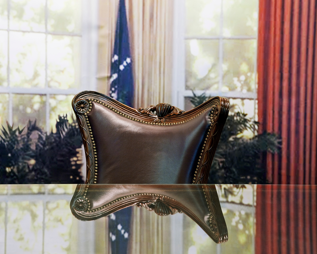 """Resolute Reflection"", Archival Pigment Print, 22x27"" and 28x34"", 2012. Replica of the presidential resolute desk and oval office designed for visitor ""photo ops"" within Plains High School, Jimmy Carter National Historic Site (Plains, GA)."