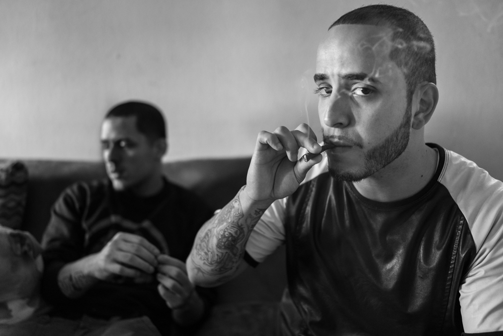 6) Demetrius smokes a joint of marijuana at his apartment in Brooklyn, Demetrius was released from jail 1 month ago after spending 3 years incarcerated.