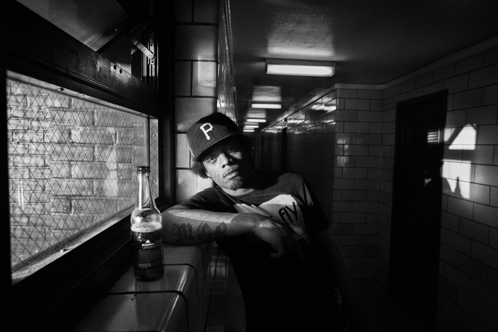 Smokey, leader of the southside Latin Kings gang in Brooklyn poses for a photo while rinking a beer inside one of the housing projects in Brooklyn.